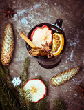 Hot mulled on dark wooden table with winter decoration Stock Photos