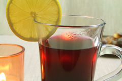 Hot mulled wine. Closeup of hot mulled wine with spices and slice of lemon Royalty Free Stock Photography