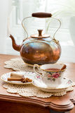 Hot mulled wine in antique English fine bone china tea cup. Royalty Free Stock Photos