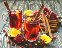 Hot mulled wine with apples, pomegranate, orange, anise and cinn Stock Images