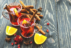 Hot mulled wine with apples, pomegranate, orange, anise and cinn Stock Image