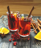 Hot mulled wine with apples, pomegranate, orange, anise and cinn Royalty Free Stock Photography
