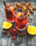 Hot mulled wine with apples, pomegranate, orange, anise and cinn Royalty Free Stock Photo
