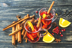 Hot mulled wine with apples, pomegranate, orange, anise and cinn Stock Photo