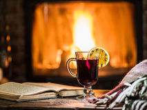 Hot mulled wine and a book on the wooden table. Stock Photo