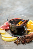 Hot mulled wine with cinnamon, slice of orange, anise and other Royalty Free Stock Image