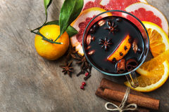 Hot mulled wine with cinnamon, slice of orange, anise and other Stock Images