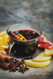 Hot mulled wine with cinnamon, slice of orange, anise and other Royalty Free Stock Photos