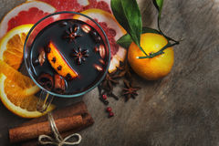 Hot mulled wine with cinnamon, slice of orange, anise and other Royalty Free Stock Images