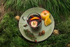 Hot mulled wine in a cup with ingredients to cook on plate. Stock Photo