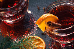 Hot mulled wine. On decorative glasses with slices of orange at Christmas atmosphere Royalty Free Stock Photo