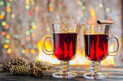 Hot mulled wine by the fire Royalty Free Stock Photo