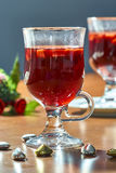 Hot mulled wine in a glass cup Royalty Free Stock Image