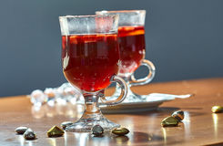 Hot mulled wine in a glass cup royalty free stock photos