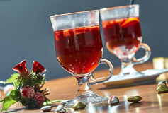 Hot mulled wine in a glass cup stock image
