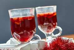 Hot mulled wine in a glass cup stock photography