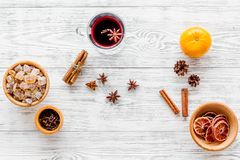 Hot mulled wine or grog cooking for new year celebration with oranges and spices ingredients on light background flat. Hot mulled wine or grog cooking for new Royalty Free Stock Photo