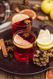 Hot mulled wine. Grog, table. Hot mulled wine with cinnamon, lemon and honey and star anise stock photos
