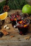 Hot mulled wine with orange and Apple Royalty Free Stock Photo