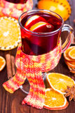 Hot mulled wine with orange slices Stock Images