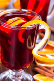 Hot mulled wine with orange slices Royalty Free Stock Photos
