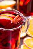 Hot mulled wine with orange slices Royalty Free Stock Images