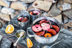 Hot mulled wine outdoor in a pot - winter or autumn picnic Stock Photography