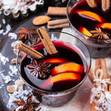Hot mulled wine in a red mug for winter holidays Stock Images