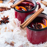 Hot mulled wine in a red mug for winter holidays Stock Photography