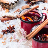Hot mulled wine in a red mug for winter holidays Stock Photo
