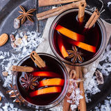 Hot mulled wine in a red mug for winter holidays Royalty Free Stock Images