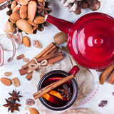 Hot mulled wine in a red mug for winter holidays Royalty Free Stock Photography