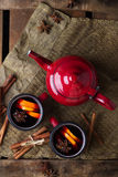 Hot mulled wine in a red mug for winter holidays Royalty Free Stock Photo