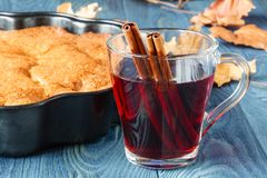 Hot mulled wine with seasonal plum pie Royalty Free Stock Photo