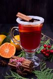 Hot mulled wine with slices of citrus fruits, cinnamon and anise in an Irish glass. Decorated with sugar border stock photos