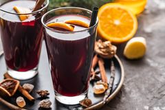 Hot mulled wine with spices, apple and orange on christmas background. Copy space. royalty free stock images