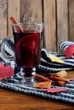 Hot Mulled wine with spices cinamon, star anise and dried lemon on knitted scarf .Fallen leaves. Autumn theme.Selective focus.Vert. Ical shot stock photos
