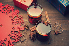 Hot mulled wine with spices, gift box and christmas decorations Royalty Free Stock Photography