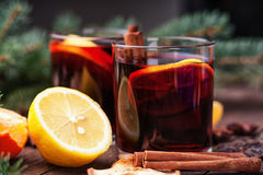 Hot mulled wine with spices and lemon Royalty Free Stock Image