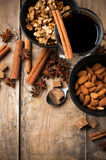 Hot mulled wine, spices and nuts Royalty Free Stock Images
