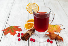 Hot mulled wine. With spices on a wooden background Royalty Free Stock Photo
