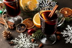 Free Hot Mulled Wine With Cinnamon And Orange In Glass Cups And Christmas Decorations On A Dark Background. Christmas. New Year Stock Photography - 133685542
