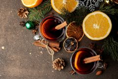 Free Hot Mulled Wine With Cinnamon And Orange In Glass Cups And Christmas Decorations On A Dark Background. View From Above. Christmas. Stock Photography - 133685592