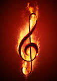 Hot Music. Musical note (treble clef) from hot charcoal on fire. Conceptual image of hot music Stock Image