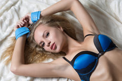 Hot naked blond with handcuffs Royalty Free Stock Images