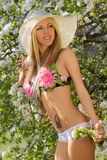 Hot natural blond over blossom trees Stock Photography