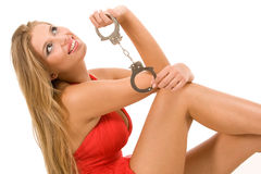 Hot natural blonde with handcuffs Royalty Free Stock Images