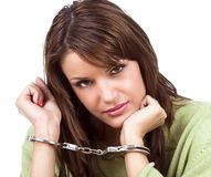 Hot natural brunette with handcuffs Royalty Free Stock Photography