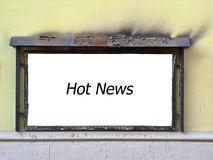 Hot news. Wall-mounted rusty billboard after the fire, ragged coat of paint royalty free stock photos