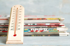 Hot news creative symbol with thermometer and newspaper Stock Image